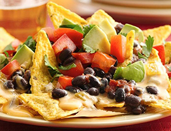 cheesy bean and sweet corn nachos